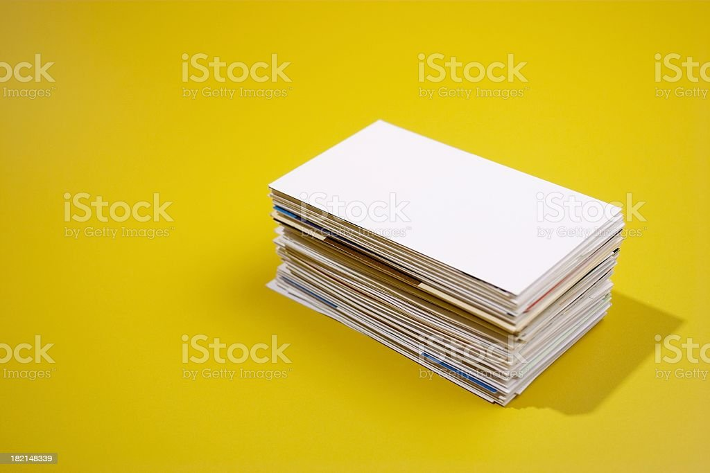 A stack of rectangular papers and folders casts a shadow royalty-free stock photo