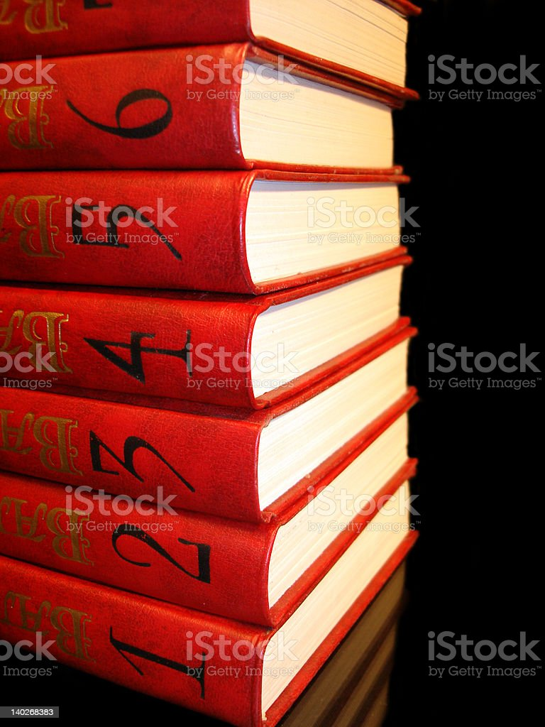 stack of red books with numbers on black background royalty-free stock photo