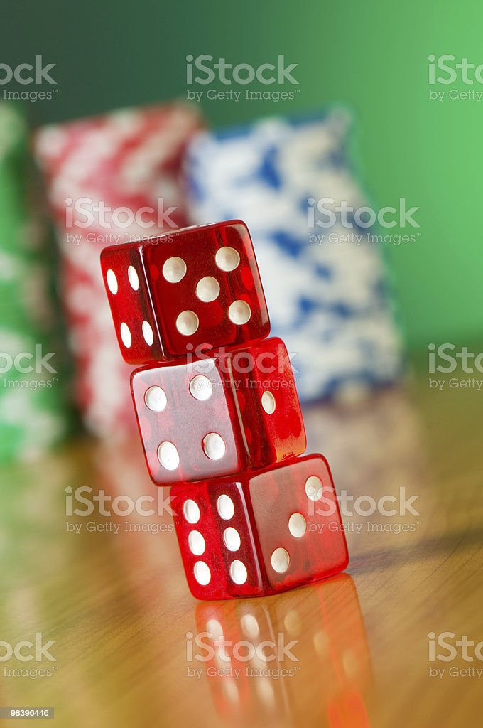 Stack of red casino dice against gradient background royalty-free stock photo