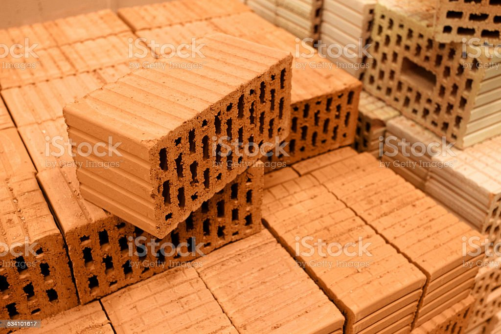 Stack of red construction bricks background stock photo