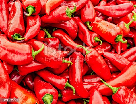 Stack of red poblano peppers for sale in market