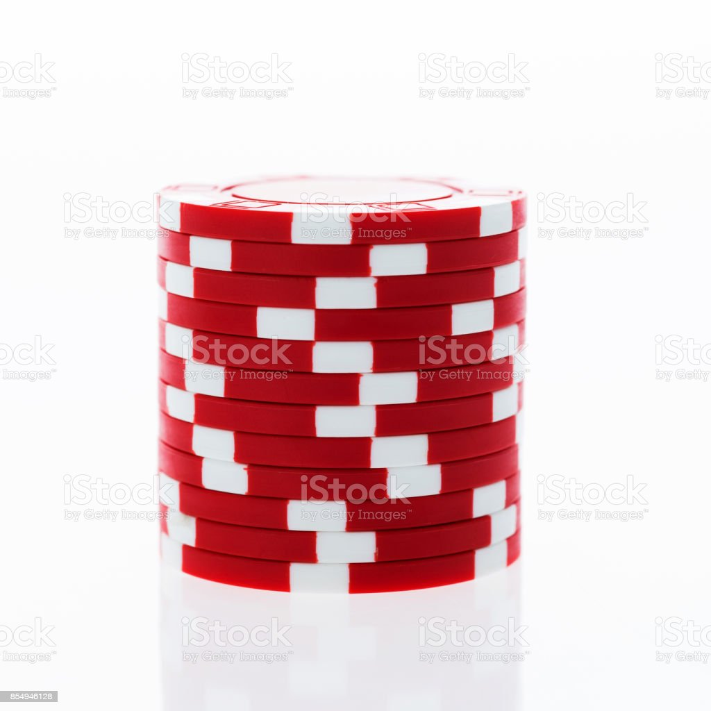 A stack of red poker chips on white background stock photo