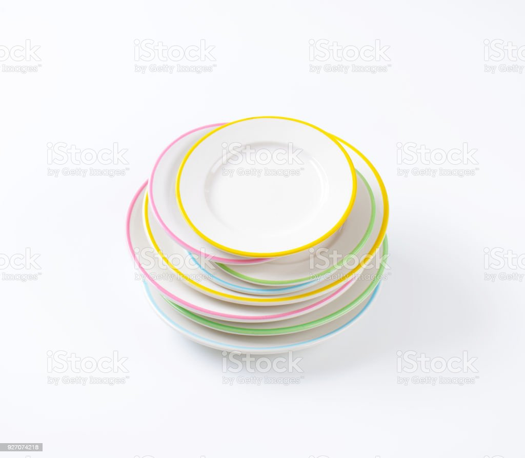 stack of rimmed plates stock photo