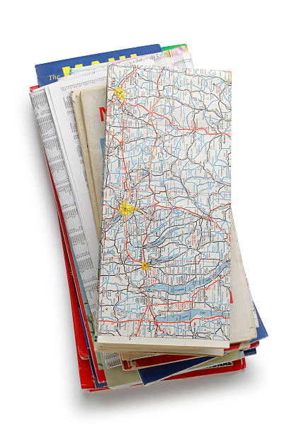 stack of road maps - road map stock photos and pictures