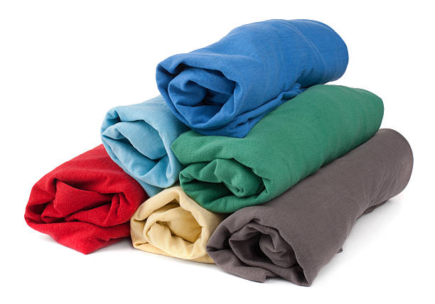 Stack of rolled t-shirts stock photo