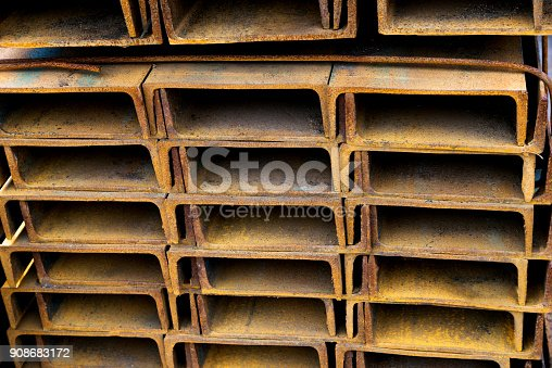 istock Stack of rusty square steel tubes 908683172