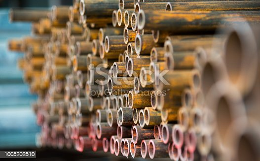 137352732istockphoto Stack of rusty steel pipes 1005202510