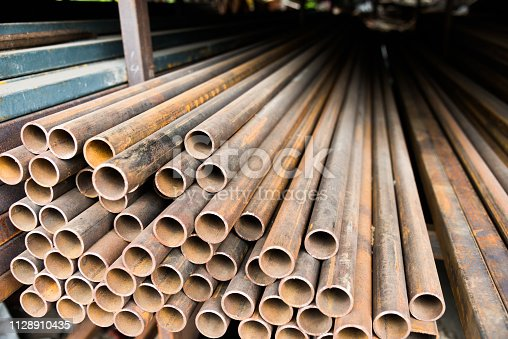 istock Stack of rusty steel pipes 1128910435