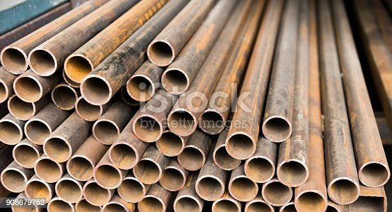 istock Stack of rusty steel pipes 908679752