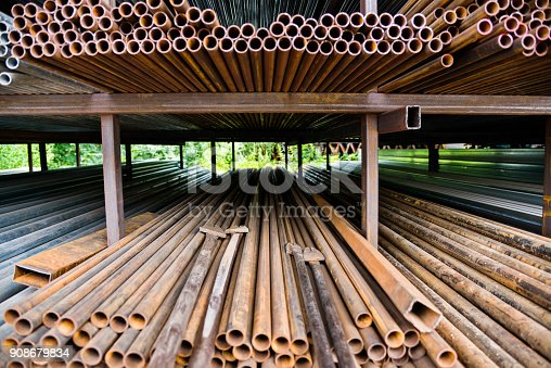 istock Stack of rusty steel pipes 908679834