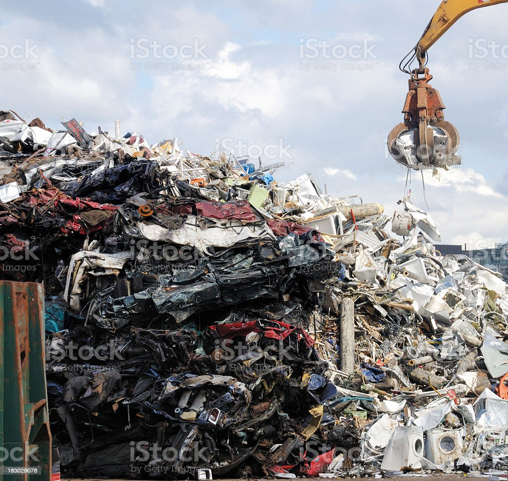 Stack of scrap metal and crane royalty-free stock photo