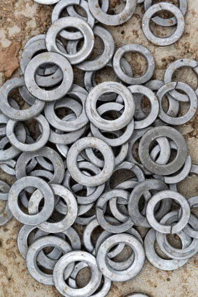 Stack of screw nuts Close view on the stack of screw nuts washer fastener stock pictures, royalty-free photos & images