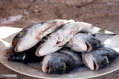 istock Stack of sea bream, Dorado fish on plate 1140336399