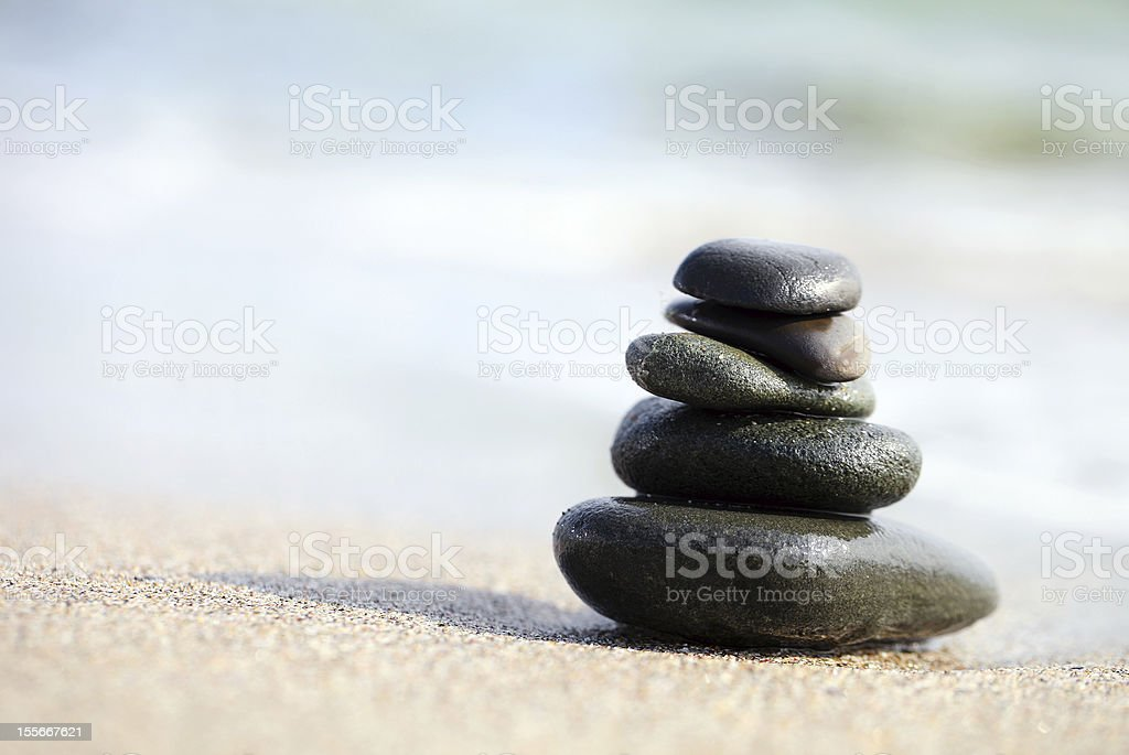 Stack of sea pebbles on the beach royalty-free stock photo