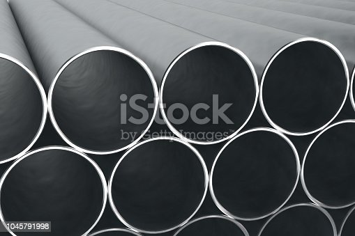 istock Stack of shiny metal steel pipes 1045791998