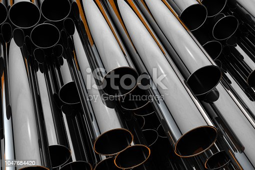 istock Stack of shiny metal steel pipes 1047684420