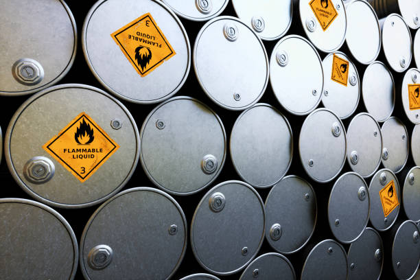 "A stack of shiny metallic oil drums with ""flammable liquid"" warning sigs NOTE FOR REVIEWERS: This image is a 3D render and does NOT have a corresponding vector file. hazardous chemicals stock pictures, royalty-free photos & images"
