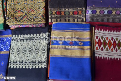 Silk clothes with embroideries in traditional Laotian patterns in various colors