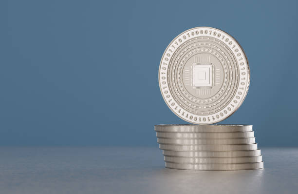 Stack of silver crypto-currency coins with cpu symbol stock photo