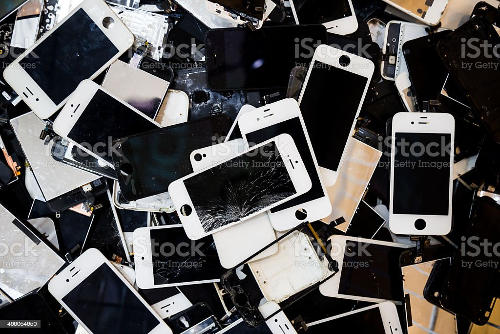 Stack of smart phones with cracked and damaged LCD screen stock photo