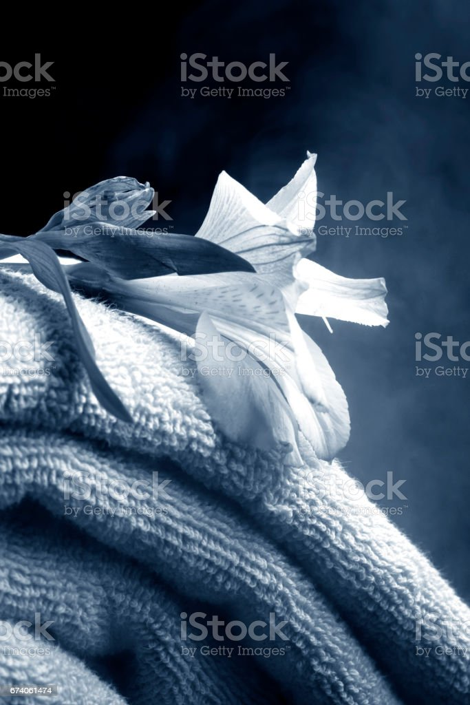 Stack of soft blue towels with flower stock photo