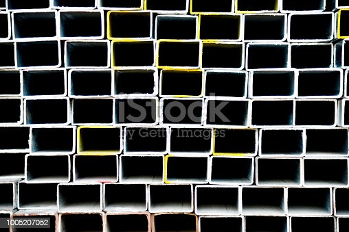 istock Stack of square steel tubes 1005207052