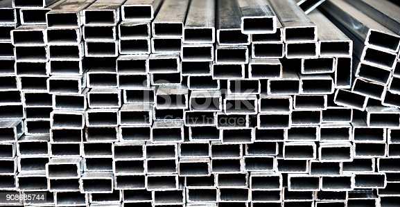 istock Stack of square steel tubes 908685744