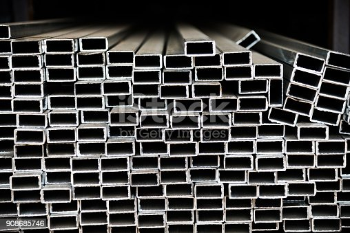 istock Stack of square steel tubes 908685746