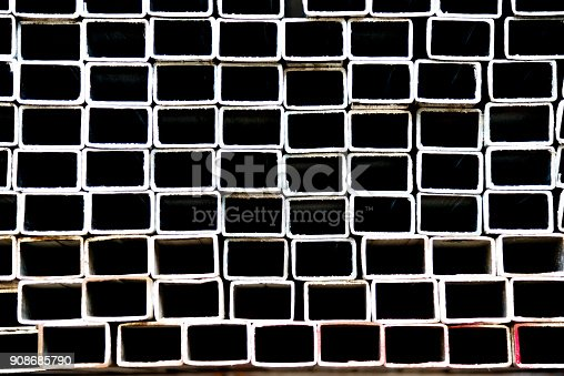 istock Stack of square steel tubes 908685790