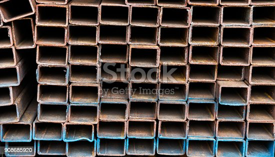 istock Stack of square steel tubes 908685920