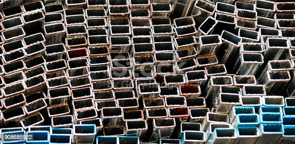 istock Stack of square steel tubes 908685922