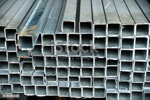 istock Stack of square steel tubes 908686048