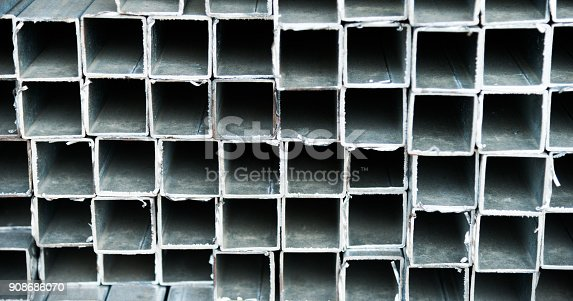 istock Stack of square steel tubes 908686070