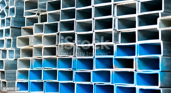 istock Stack of square steel tubes 908686138