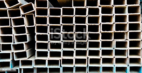istock Stack of square steel tubes 908686146