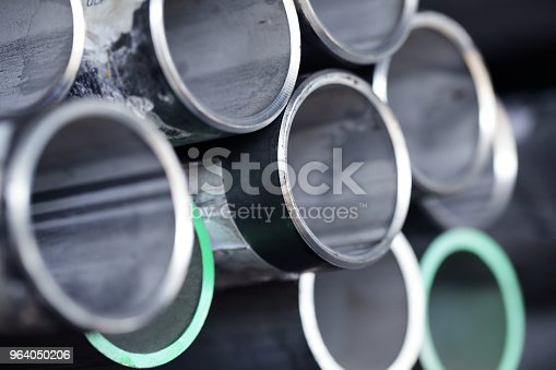 istock stack of stainless tube steel pipe background. 964050206