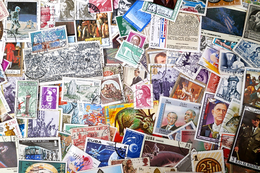 Stack of stamps from all around the world.