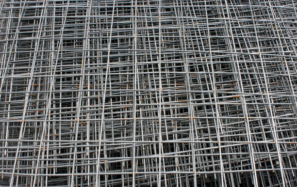 Stack of steel construction mesh with rust. Steel mesh background. Horizontal photo stock photo