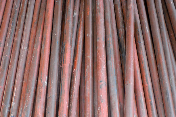 Stack of steel pipes close up – zdjęcie