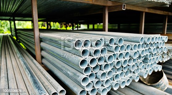 istock Stack of steel pipes on the shelf 1005206676