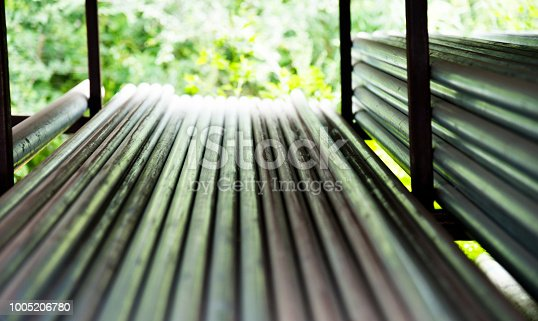 istock Stack of steel pipes on the shelf 1005206780