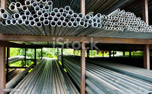 istock Stack of steel pipes on the shelf 1005207048