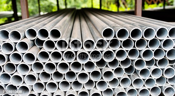 istock Stack of steel pipes on the shelf 1128910438