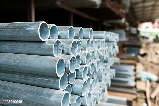 istock Stack of steel pipes on the shelf 1128910546