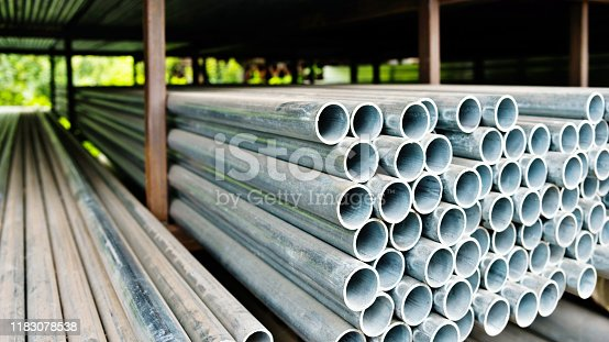 137352732istockphoto Stack of steel pipes on the shelf 1183078538