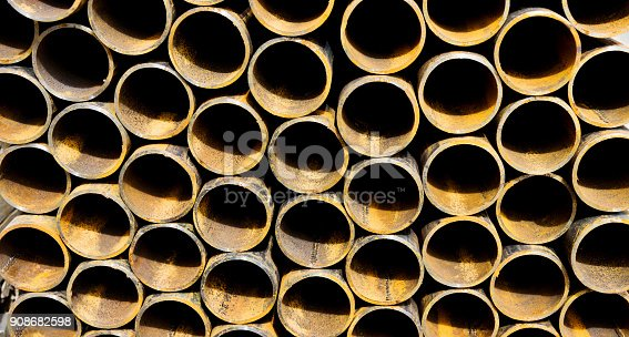istock Stack of steel pipes on the shelf 908682598