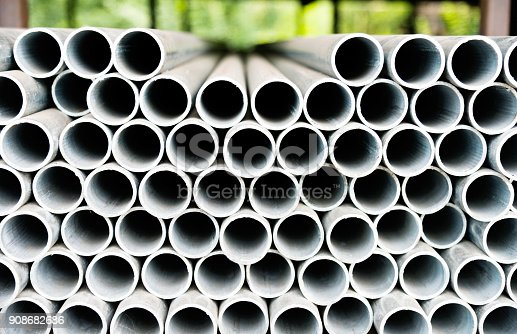istock Stack of steel pipes on the shelf 908682686