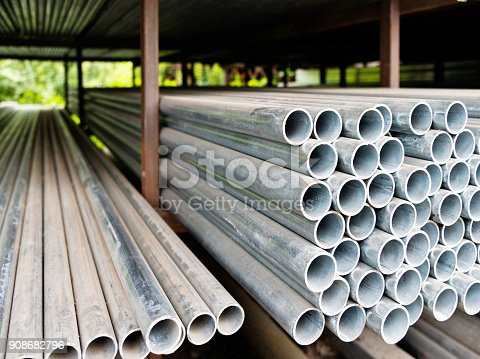 istock Stack of steel pipes on the shelf 908682796