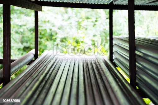 istock Stack of steel pipes on the shelf 908682958