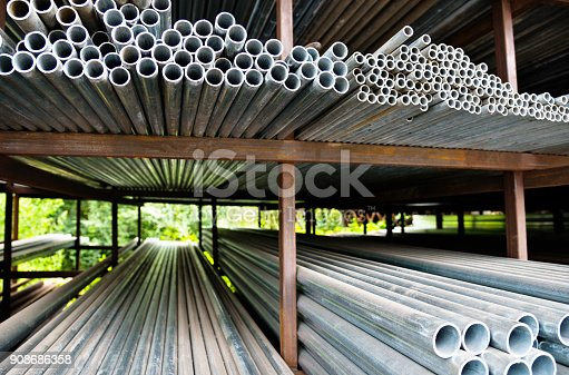 istock Stack of steel pipes on the shelf 908686358